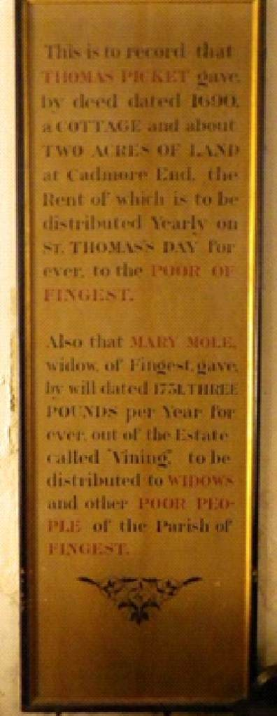 Board situated on the wall of the nave to the right of the south door remembering the Thomas Picket and Mary Mole charities.