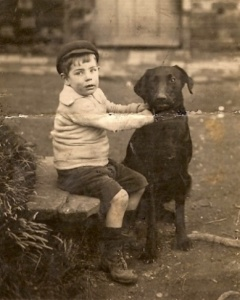 A young Raymond Druce at Rabbit Skin Row with Peter the dog.